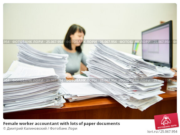 Female worker accountant with lots of paper documents. Стоковое фото, фотограф Дмитрий Калиновский / Фотобанк Лори