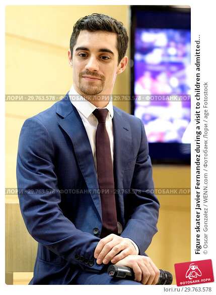 Купить «Figure skater Javier Fernandez during a visit to children admitted to the Gregorio Marañón Hospital in Madrid, Spain, showing them his bronze medal won...», фото № 29763578, снято 20 февраля 2018 г. (c) age Fotostock / Фотобанк Лори