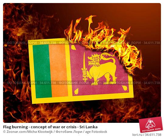 Flag burning - concept of war or crisis - Sri Lanka. Стоковое фото, фотограф Zoonar.com/Micha Klootwijk / age Fotostock / Фотобанк Лори