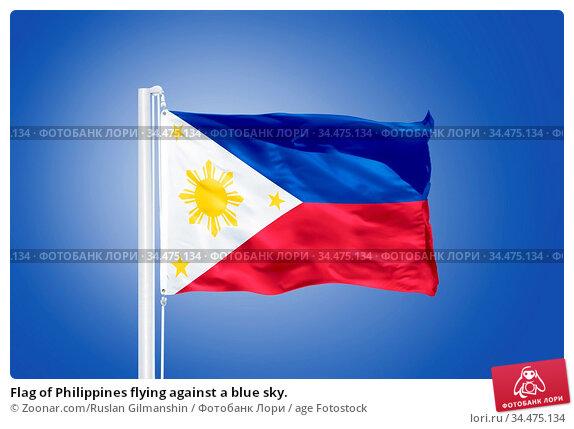 Flag of Philippines flying against a blue sky. Стоковое фото, фотограф Zoonar.com/Ruslan Gilmanshin / age Fotostock / Фотобанк Лори
