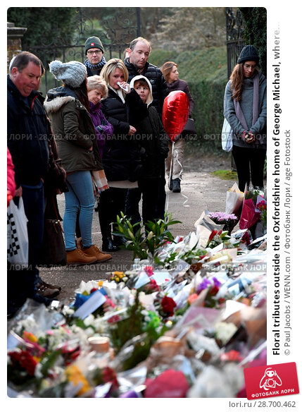 Купить «Floral tributes outside the Oxfordshire home of George Michael, where he was found dead on Christmas Day at Goring-on-Thames Featuring: Atmosphere Where...», фото № 28700462, снято 28 декабря 2016 г. (c) age Fotostock / Фотобанк Лори