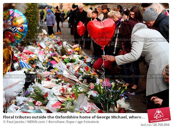 Купить «Floral tributes outside the Oxfordshire home of George Michael, where he was found dead on Christmas Day at Goring-on-Thames Featuring: Atmosphere Where...», фото № 28700894, снято 28 декабря 2016 г. (c) age Fotostock / Фотобанк Лори