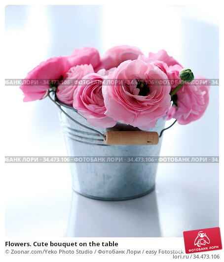 Flowers. Cute bouquet on the table. Стоковое фото, фотограф Zoonar.com/Yeko Photo Studio / easy Fotostock / Фотобанк Лори
