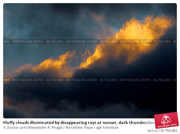 Fluffy clouds illuminated by disappearing rays at sunset, dark thunderclouds... Стоковое фото, фотограф Zoonar.com/Alexsander A. Piragis / age Fotostock / Фотобанк Лори