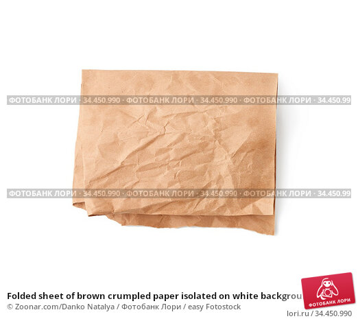 Folded sheet of brown crumpled paper isolated on white background... Стоковое фото, фотограф Zoonar.com/Danko Natalya / easy Fotostock / Фотобанк Лори