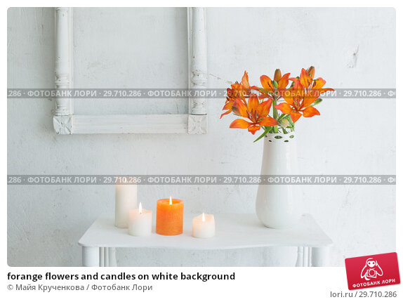 Купить «forange flowers and candles on white background», фото № 29710286, снято 1 июня 2018 г. (c) Майя Крученкова / Фотобанк Лори