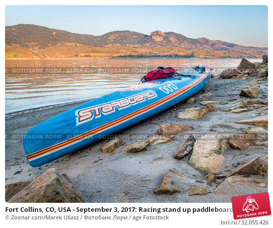 Fort Collins, CO, USA - September 3, 2017: Racing stand up paddleboard (All Star by Starboard) on a calm Horsetooth Reservoir at sunrise during Labor Day... Стоковое фото, фотограф Zoonar.com/Marek Uliasz / age Fotostock / Фотобанк Лори