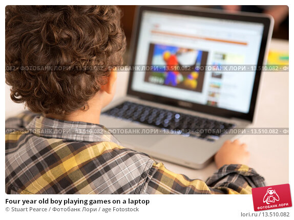 Купить «Four year old boy playing games on a laptop», фото № 13510082, снято 31 марта 2020 г. (c) age Fotostock / Фотобанк Лори