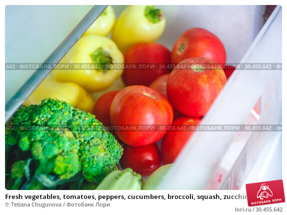 Fresh vegetables, tomatoes, peppers, cucumbers, broccoli, squash, zucchini in the refrigerator drawer for vegetables. Стоковое фото, фотограф Tetiana Chugunova / Фотобанк Лори
