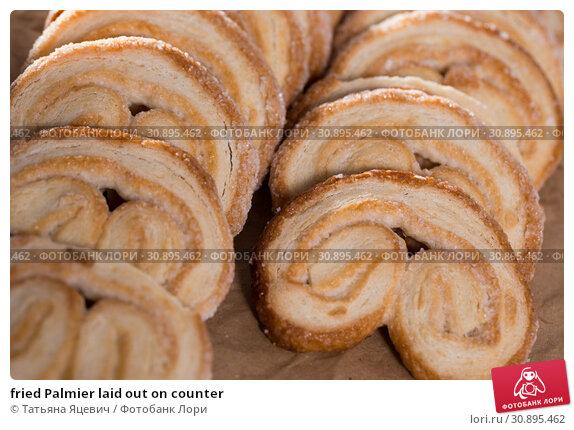 Купить «fried Palmier laid out on counter», фото № 30895462, снято 30 января 2018 г. (c) Татьяна Яцевич / Фотобанк Лори