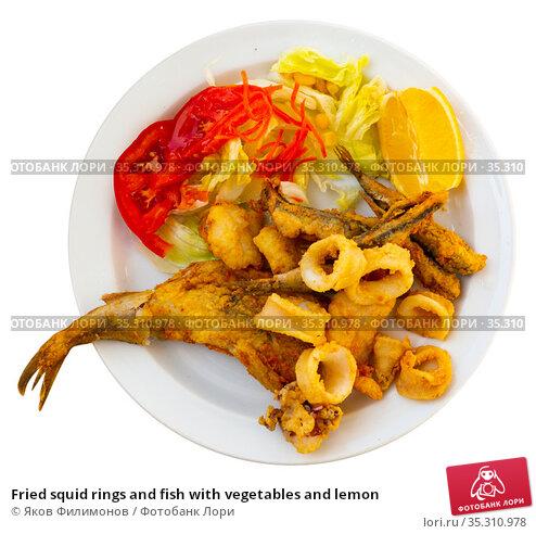 Fried squid rings and fish with vegetables and lemon. Стоковое фото, фотограф Яков Филимонов / Фотобанк Лори
