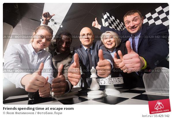 Купить «Friends spending time at escape room», фото № 33429142, снято 29 января 2019 г. (c) Яков Филимонов / Фотобанк Лори