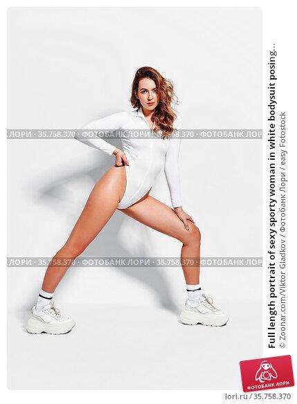 Full length portrait of sexy sporty woman in white bodysuit posing... Стоковое фото, фотограф Zoonar.com/Viktor Gladkov / easy Fotostock / Фотобанк Лори