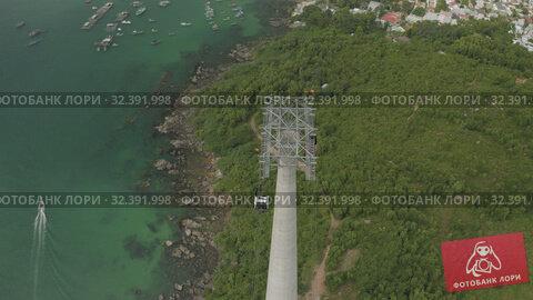 Купить «Funicular cable car on Phu Quoc Island to Hon Thom Pineapple Island in Vietnam», видеоролик № 32391998, снято 4 ноября 2019 г. (c) Aleksejs Bergmanis / Фотобанк Лори