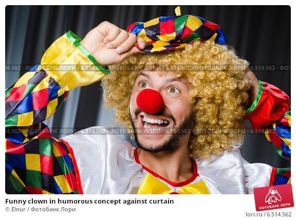 Купить «Funny clown in humorous concept against curtain», фото № 6514562, снято 18 июля 2014 г. (c) Elnur / Фотобанк Лори