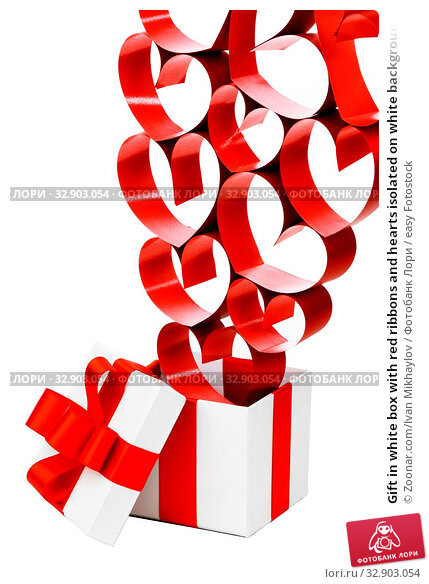Gift in white box with red ribbons and hearts isolated on white background. Стоковое фото, фотограф Zoonar.com/Ivan Mikhaylov / easy Fotostock / Фотобанк Лори