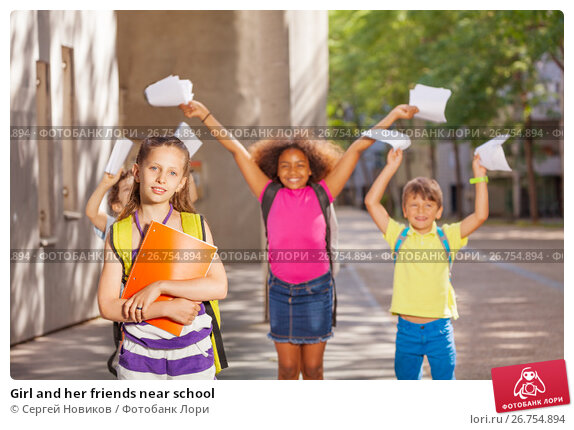 Купить «Girl and her friends near school», фото № 26754894, снято 17 июня 2017 г. (c) Сергей Новиков / Фотобанк Лори