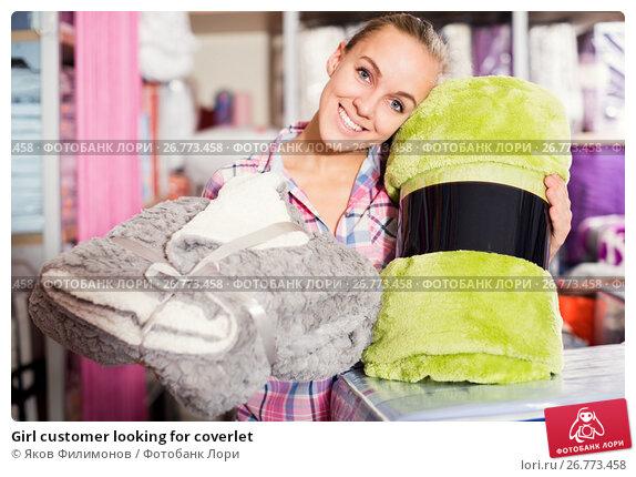 Купить «Girl customer looking for coverlet», фото № 26773458, снято 24 мая 2018 г. (c) Яков Филимонов / Фотобанк Лори