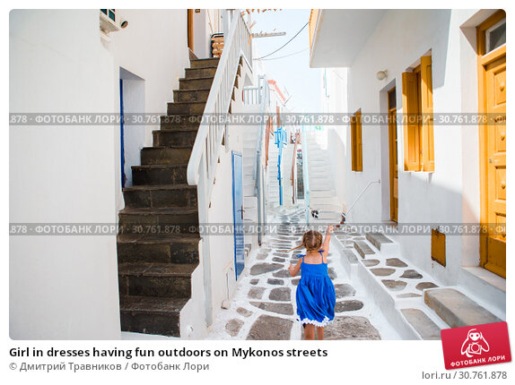 Купить «Girl in dresses having fun outdoors on Mykonos streets», фото № 30761878, снято 21 августа 2016 г. (c) Дмитрий Травников / Фотобанк Лори