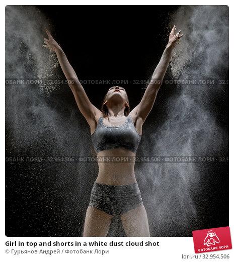 Girl in top and shorts in a white dust cloud shot. Стоковое фото, фотограф Гурьянов Андрей / Фотобанк Лори