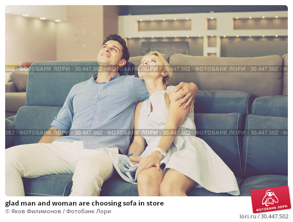 Купить «glad man and woman are choosing sofa in store», фото № 30447502, снято 19 июня 2017 г. (c) Яков Филимонов / Фотобанк Лори