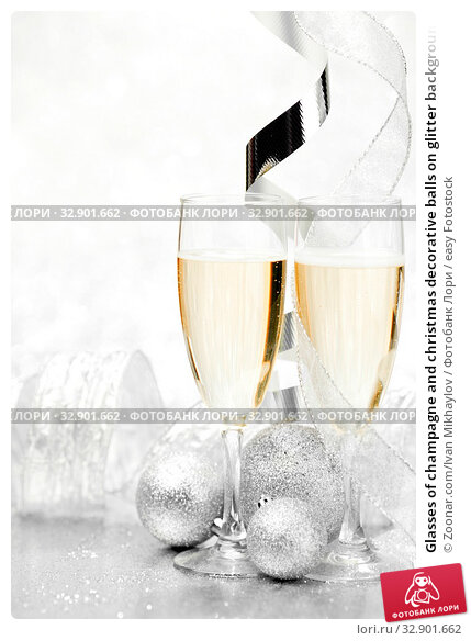 Glasses of champagne and christmas decorative balls on glitter background. Стоковое фото, фотограф Zoonar.com/Ivan Mikhaylov / easy Fotostock / Фотобанк Лори