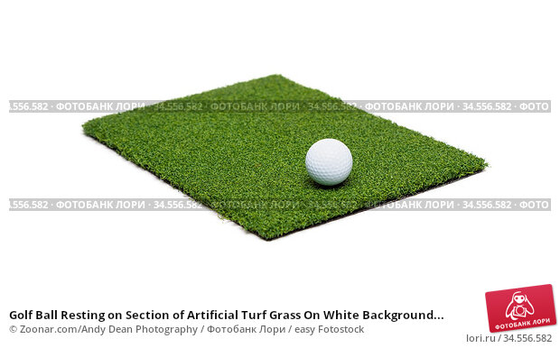 Golf Ball Resting on Section of Artificial Turf Grass On White Background... Стоковое фото, фотограф Zoonar.com/Andy Dean Photography / easy Fotostock / Фотобанк Лори