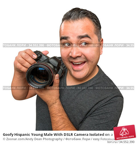 Goofy Hispanic Young Male With DSLR Camera Isolated on a White Background... Стоковое фото, фотограф Zoonar.com/Andy Dean Photography / easy Fotostock / Фотобанк Лори