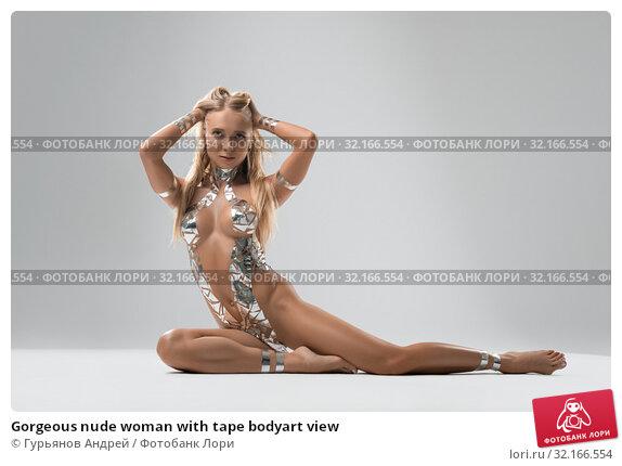 Купить «Gorgeous nude woman with tape bodyart view», фото № 32166554, снято 26 августа 2019 г. (c) Гурьянов Андрей / Фотобанк Лори