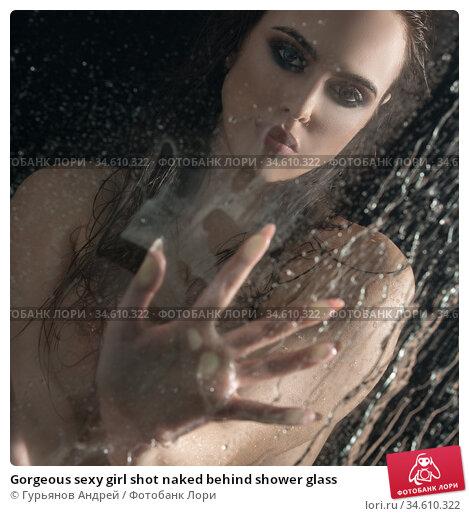 Gorgeous sexy girl shot naked behind shower glass. Стоковое фото, фотограф Гурьянов Андрей / Фотобанк Лори