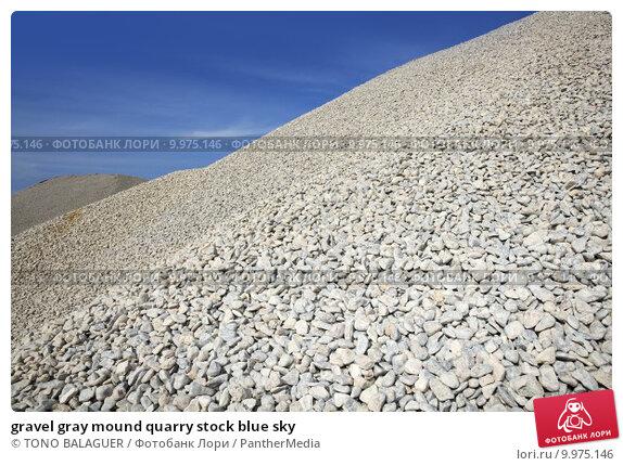 Купить «gravel gray mound quarry stock blue sky», фото № 9975146, снято 22 ноября 2019 г. (c) PantherMedia / Фотобанк Лори