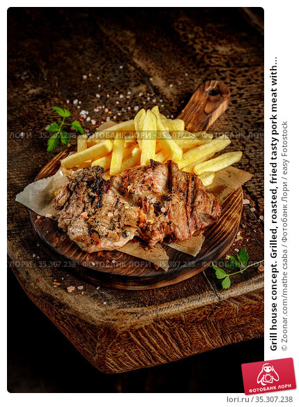 Grill house concept. Grilled, roasted, fried tasty pork meat with... Стоковое фото, фотограф Zoonar.com/mathe csaba / easy Fotostock / Фотобанк Лори