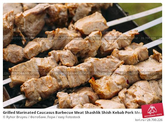 Купить «Grilled Marinated Caucasus Barbecue Meat Shashlik Shish Kebab Pork Meat Grilling On Metal Skewer. Nobody.», фото № 28700226, снято 17 июня 2016 г. (c) easy Fotostock / Фотобанк Лори