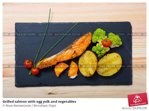 Купить «Grilled salmon with egg yolk and vegetables», фото № 29070278, снято 20 февраля 2019 г. (c) Яков Филимонов / Фотобанк Лори