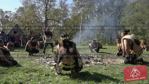 Group Itelmens people dancing ritual dance near fire and scream in traditional clothing indigenous. Itelmens national ritual festival thanksgiving nature Alhalalalay. Kamchatka Peninsula (2019 год). Редакционное видео, видеограф А. А. Пирагис / Фотобанк Лори