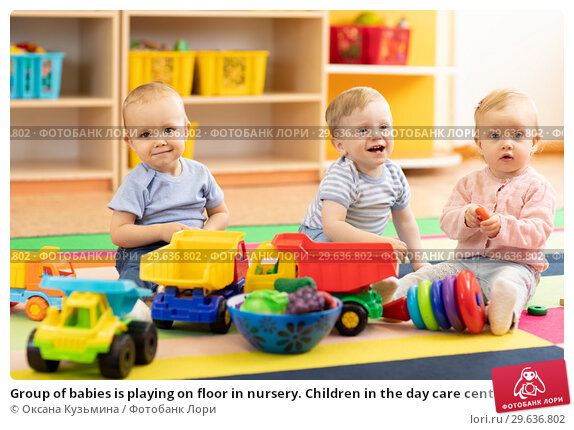 Купить «Group of babies is playing on floor in nursery. Children in the day care center. Fun in the children's playroom», фото № 29636802, снято 22 апреля 2019 г. (c) Оксана Кузьмина / Фотобанк Лори
