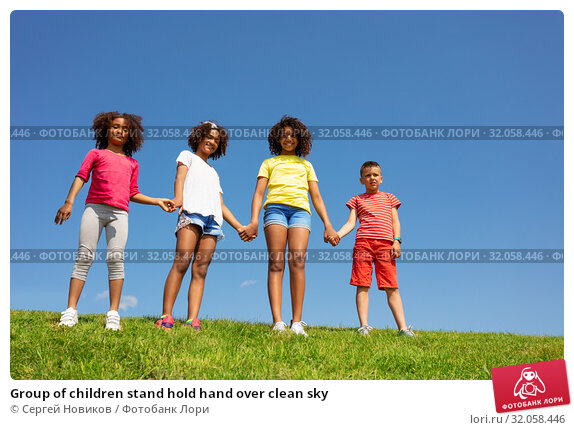 Group of children stand hold hand over clean sky. Стоковое фото, фотограф Сергей Новиков / Фотобанк Лори