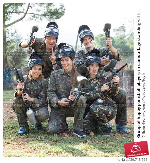 Купить «Group of happy paintball players in camouflage standing with guns outdoors», фото № 29713794, снято 22 сентября 2018 г. (c) Яков Филимонов / Фотобанк Лори
