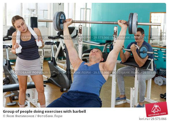 Купить «Group of people doing exercises with barbell», фото № 29573066, снято 5 ноября 2018 г. (c) Яков Филимонов / Фотобанк Лори