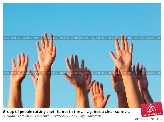 Group of people raising their hands in the air against a clear sunny... Стоковое фото, фотограф Zoonar.com/Danil Roudenko / age Fotostock / Фотобанк Лори