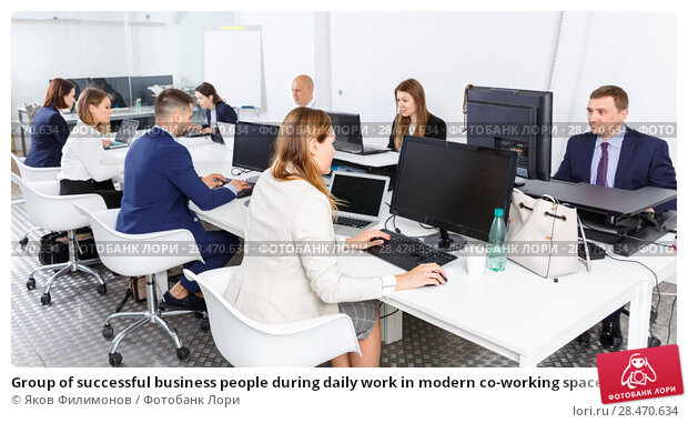Group of successful business people during daily work in modern co-working space. Стоковое фото, фотограф Яков Филимонов / Фотобанк Лори