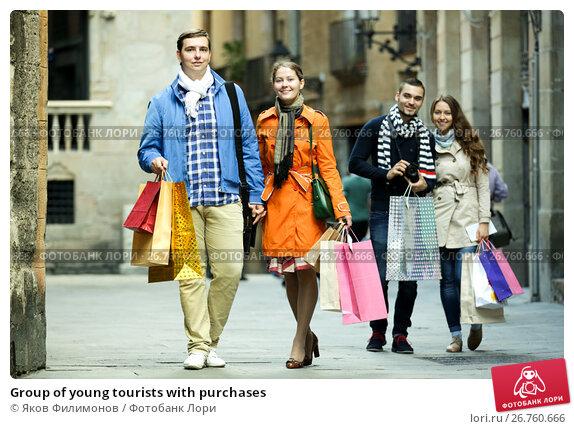 Group of young tourists with purchases, фото № 26760666, снято 26 сентября 2017 г. (c) Яков Филимонов / Фотобанк Лори