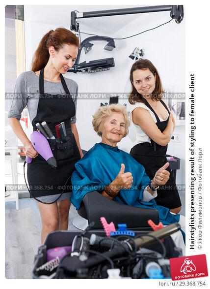 Купить «Hairstylists presenting result of styling to female client», фото № 29368754, снято 26 июня 2018 г. (c) Яков Филимонов / Фотобанк Лори