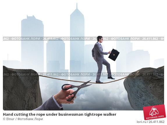 Купить «Hand cutting the rope under businessman tightrope walker», фото № 26411862, снято 13 июля 2020 г. (c) Elnur / Фотобанк Лори