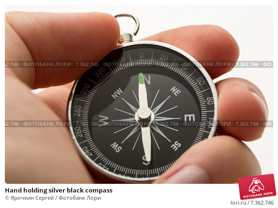 Купить «Hand holding silver black compass», фото № 7362746, снято 19 августа 2012 г. (c) Ярочкин Сергей / Фотобанк Лори