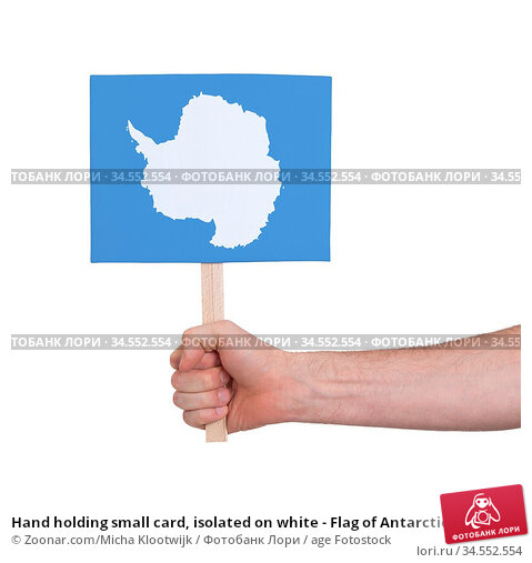 Hand holding small card, isolated on white - Flag of Antarctica. Стоковое фото, фотограф Zoonar.com/Micha Klootwijk / age Fotostock / Фотобанк Лори