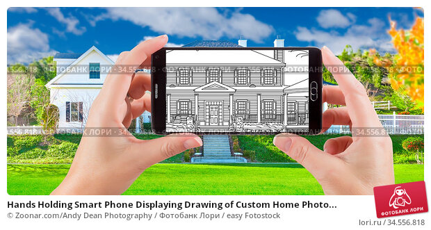 Hands Holding Smart Phone Displaying Drawing of Custom Home Photo... Стоковое фото, фотограф Zoonar.com/Andy Dean Photography / easy Fotostock / Фотобанк Лори