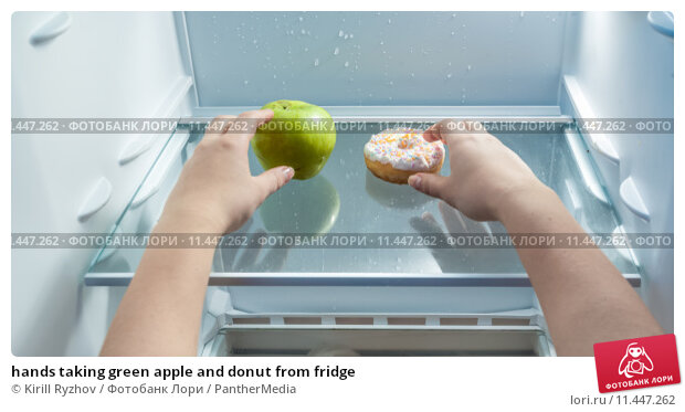 Купить «hands taking green apple and donut from fridge», фото № 11447262, снято 15 сентября 2019 г. (c) PantherMedia / Фотобанк Лори