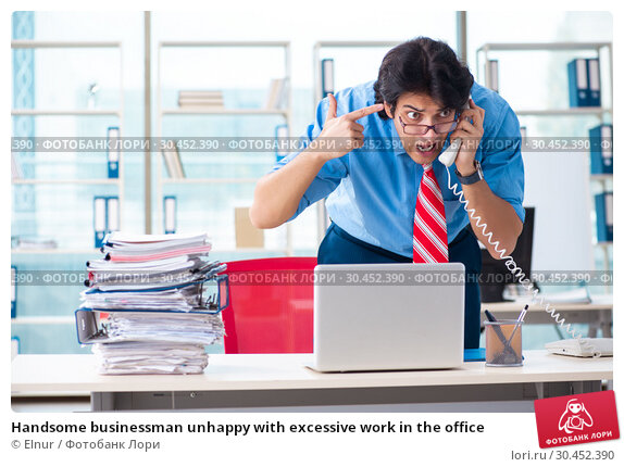Handsome businessman unhappy with excessive work in the office. Стоковое фото, фотограф Elnur / Фотобанк Лори