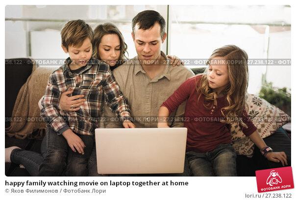 Купить «happy family watching movie on laptop together at home», фото № 27238122, снято 23 декабря 2016 г. (c) Яков Филимонов / Фотобанк Лори